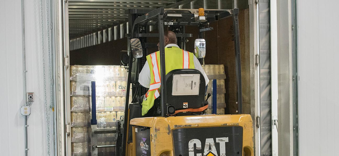 Valley Wide Beverage warehouse interior with worker
