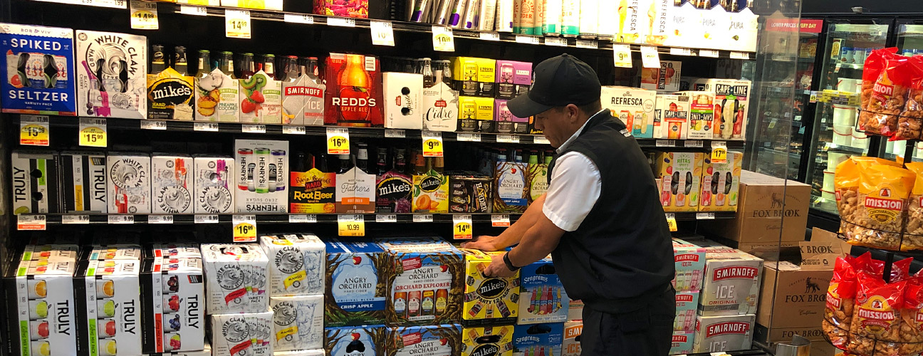 Person stocking the shelves at a grocery store